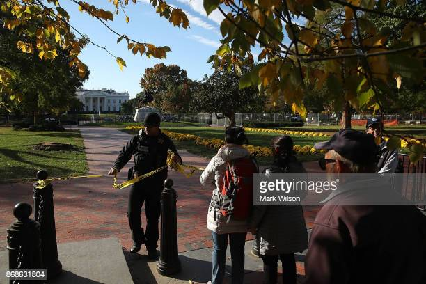 A member of the US Secret Service removes police tape after Lafayette square was temporally closed as US Vice President Mike Pence's motorcade passed...