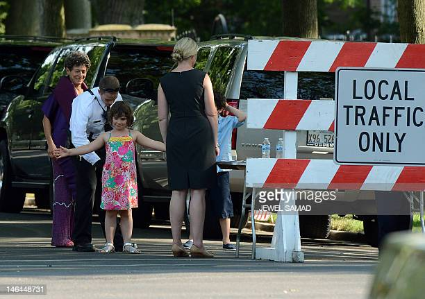 A member of the US Secret Service scans a young girl guest arriving to at the Valerie Jarrett's house to attend her daughter Laura Jarret's wedding...