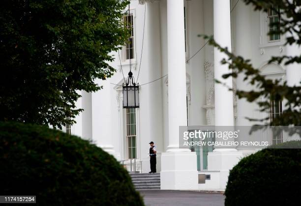 A member of the US Secret Service stands at attention outside the entrance to the White House on October 6 2019 in Washington DC A second...