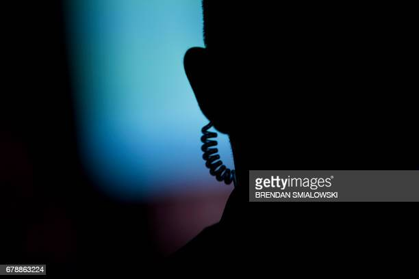 A member of the US Secret Service stands guard during a dinner to commemorate the 75th anniversary of the Battle of the Coral Sea during WWII on...