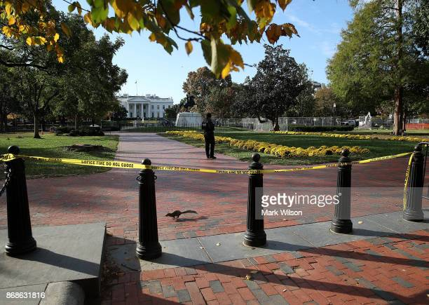 A member of the US Secret Service stands guard in Lafayette square shortly before US Vice President Mike Pence's motorcade passes by on October 31...
