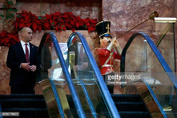 A member of the US Secret Service stands next to a toy soldier decoration at Trump Tower November 28 2016 in New York City Presidentelect Donald...