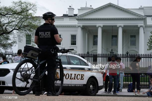 A member of the US Secret Service Uniformed Division stands by his bicycle outside the White House on April 08 2019 in Washington DC Today it was...
