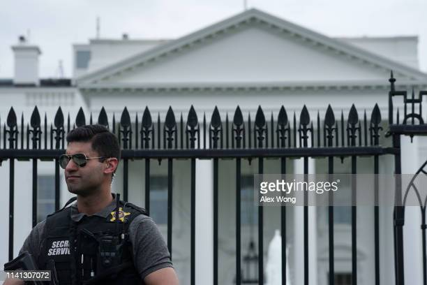 A member of the US Secret Service Uniformed Division stands guard outside the White House on April 08 2019 in Washington DC Today it was announced...