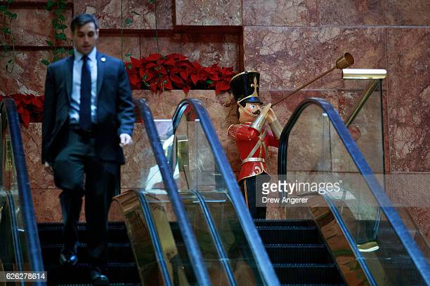 A member of the US Secret Service walks past a toy soldier decoration at Trump Tower November 28 2016 in New York City Presidentelect Donald Trump...