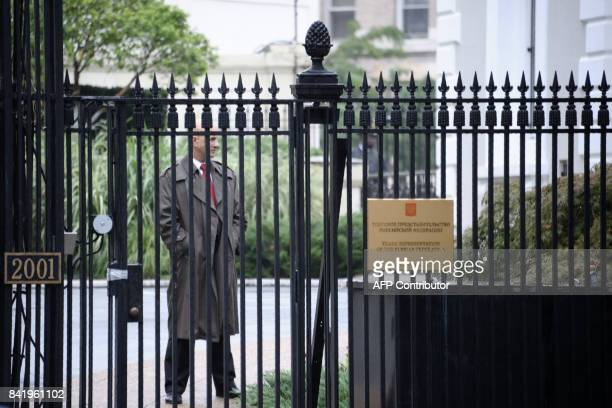 A member of the US State Department police is seen inside the compound of the Trade Representation building of the Russian Federation on September 2...