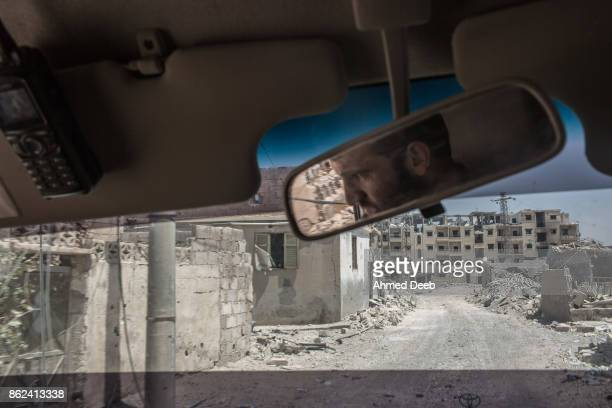Member of the US-backed Syrian Democratic Forces drives an armored vehicle on the frontlines with Islamic State in the Edikhar housing near the Nahda...