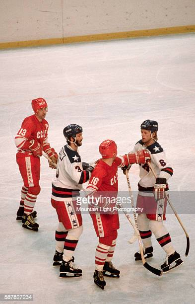 Member of the USSR Olympic ice hockey squad shoves a member of the US team during a game at the 1980 Winter Olympics in Lake Placid, New York.