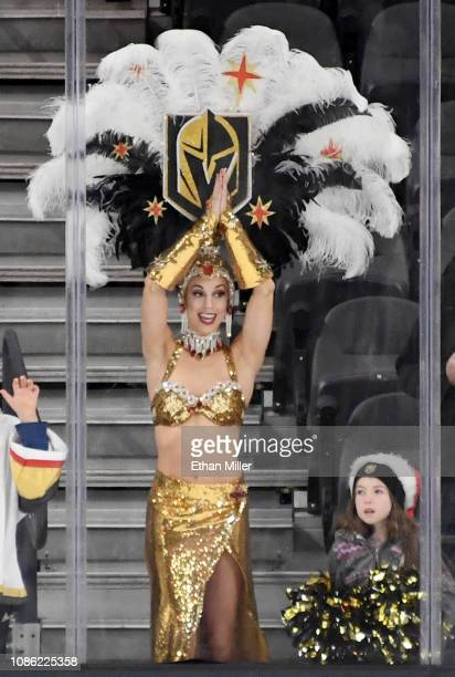 A member of the Vegas Belles stands behind the glass on the Los Angeles Kings' end of the ice during warmups before a game between the Kings and the...