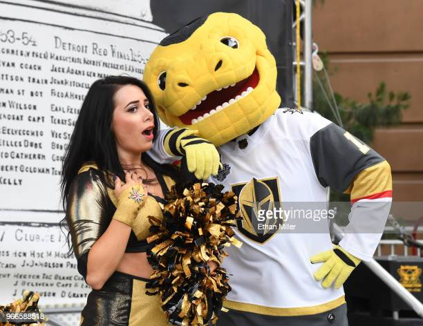 A member of the Vegas Golden Knights Golden Aces and mascot Chance the Golden Gila Monster joke around during a Golden Knights road game watch party...