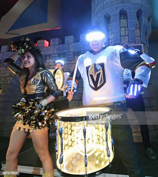A member of the Vegas Golden Knights Golden Aces cheers as members of the Vegas Golden Knights Knight Line Drumbots perform in the Castle during a...
