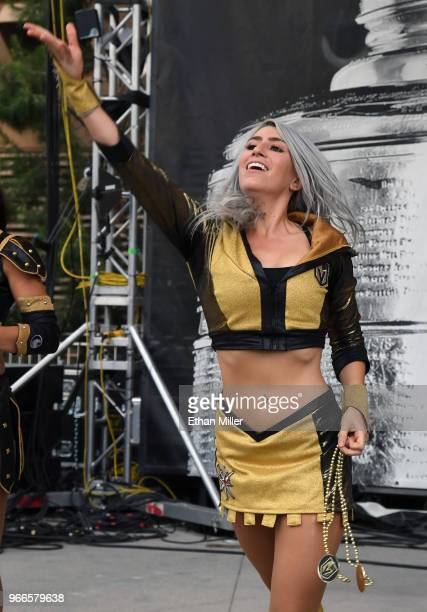 A member of the Vegas Golden Knights Golden Aces throws prizes to the crowd during a Golden Knights road game watch party for Game Three of the 2018...