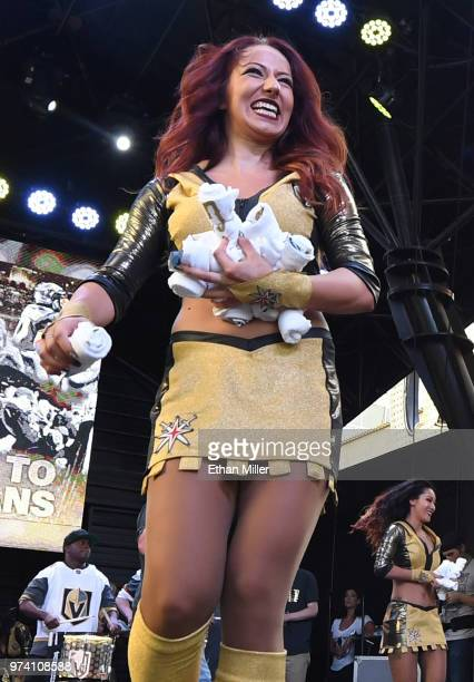 A member of the Vegas Golden Knights Golden Aces throws Tshirts to fans during the team's 'Stick Salute to Vegas and Our Fans' event at the Fremont...