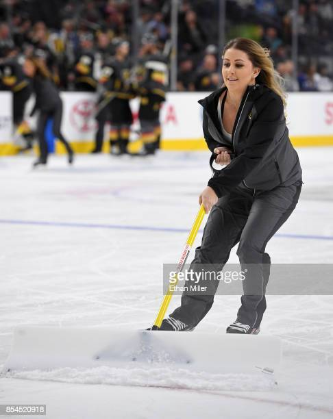 A member of the Vegas Golden Knights ice girls cleans the ice during a break in the team's preseason game against the Los Angeles Kings at TMobile...