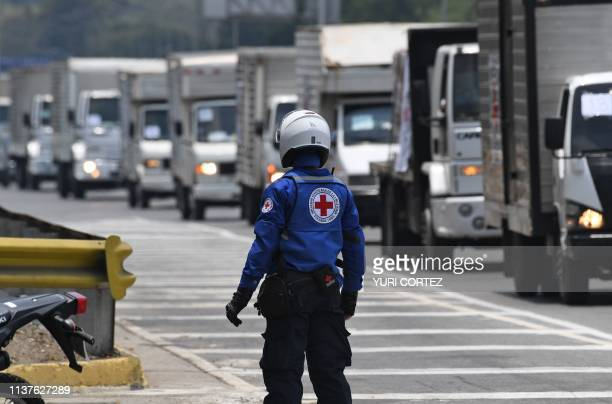 A member of the Venezuelan Red Cross supervises the arrival of the first shipment of humanitarian aid to Venezuela at the organization's headquarters...