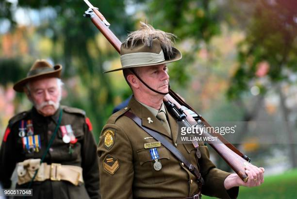 A member of the Victoria Police Shrine Guard wearing his ceremonial uniform stands to attention during a service at Melbourne's Shrine of Remembrance...