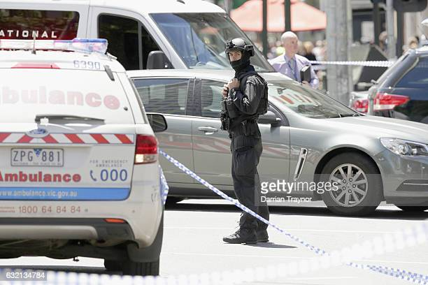 A member of the Victoria Police Special Operations Group stands on the corner of Bourke and Elizabeth streets on January 20 2017 in Melbourne...