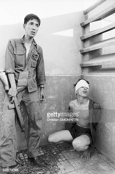 A member of the Vietcong is held prisoner by the South Vietnamese army during the second attack on Saigon during the Tet Offensive