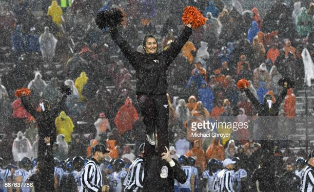 A member of the Virginia Tech Hokies cheerleading squad performs in the second half of the game against the Duke Blue Devils at Lane Stadium on...