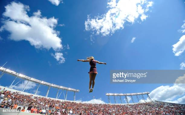 A member of the Virginia Tech Hokies cheerleading squad performs prior to the game against the Delaware Fightin Blue Hens at Lane Stadium on...