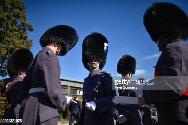 A member of the Welsh Guards is presented with a leek during a parade on St David's Day on March 1 2020 in Windsor England The 1st Battalion Welsh...