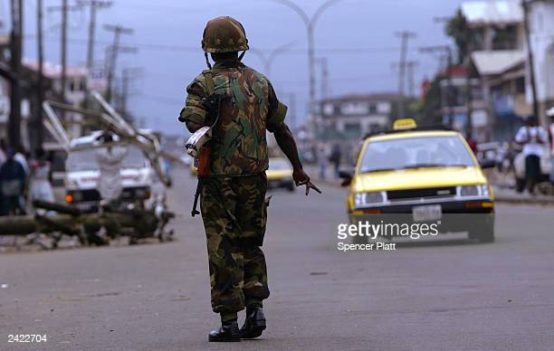 A member of the West African ECOMIL peacekeeping force mans a roadblock August 24 2003 in Monrovia Liberia Renewed fighting between Liberian...