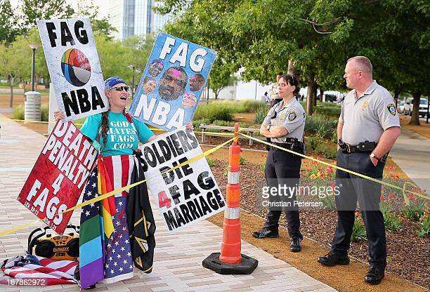 A member of the Westboro Baptist Church protests gay rights and the NBA as police officers look on before Game Five of the Western Conference...