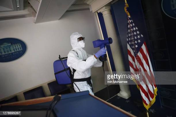 Member of the White House cleaning staff sanitizes the James S. Brady Press Briefing Room on October 05, 2020 in Washington, DC. U.S. President...