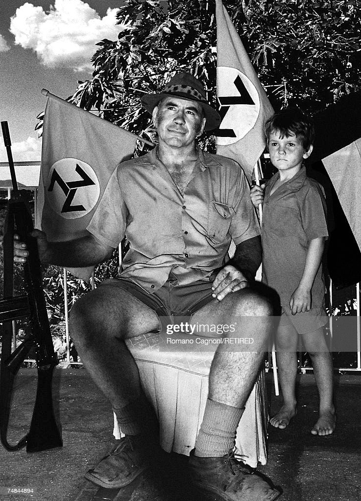 A member of the white supremacist Afrikaner Resistance Movement (AWB) and his son, South Africa, 1989.