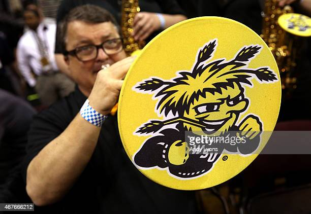 A member of the Wichita State Shockers band performs at halftime against the Notre Dame Fighting Irish during the Midwest Regional semifinal of the...