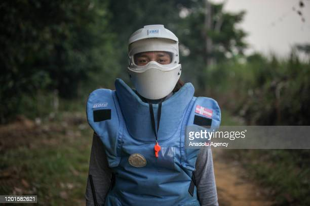 Member of the women demining team takes part in a search for explosive ordnances at the southern Colombian jungle of Caqueta Department in Milan,...