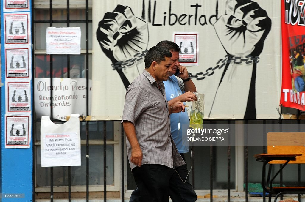 A member of the Workers Union of the National Autonomous University of Honduras his helped as with other nine coworkers stand their 24th day of hunger strike demanding the restitution of 180 dismissed employees, in Tegucigalpa on May 20, 2010. AFP PHOTO/Orlando SIERRA