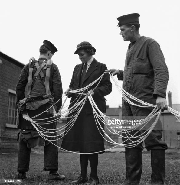 A member of the WRNS the women's branch of the Royal Navy learns how to untangle the ropes of a parachute during her tour of duty on the 'HMS...