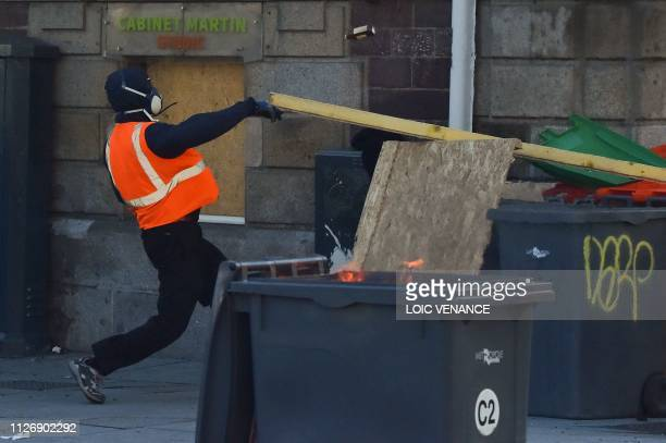 A member of the yellow vest takes part in the 15th consecutive Saturday of demonstrations in Rennes western France on February 23 2019 Demonstrators...