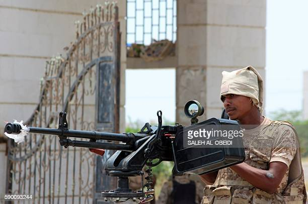 A member of the Yemeni government forces stands in the back of an armed vehicle in Zinjibar on August 16 2016 after they entered the capital of the...