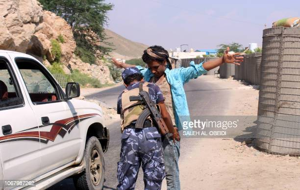 A member of the Yemeni security forces frisks a man at a checkpoint in the former AlQaeda in the Arabian Peninsula jihadist's bastion of Mukalla in...