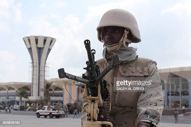A member of the Yemeni security forces loyal to President Abedrabbo Mansour Hadi guards Aden's international airport after Popular Resistance...