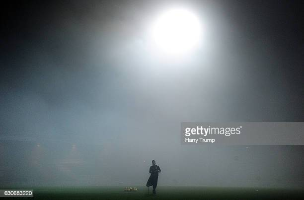 A member of the Yeovil Town staff walks across the pitch prior to kick off during the Sky Bet League Two match between Yeovil Town and Portsmouth at...