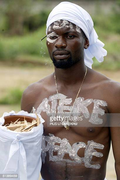 A member of Tom Ateke's militia Niger Delta Vigilante Service takes part in a peace rally in Okrika 04 October 2004 Tom Ateke a warlord who has...