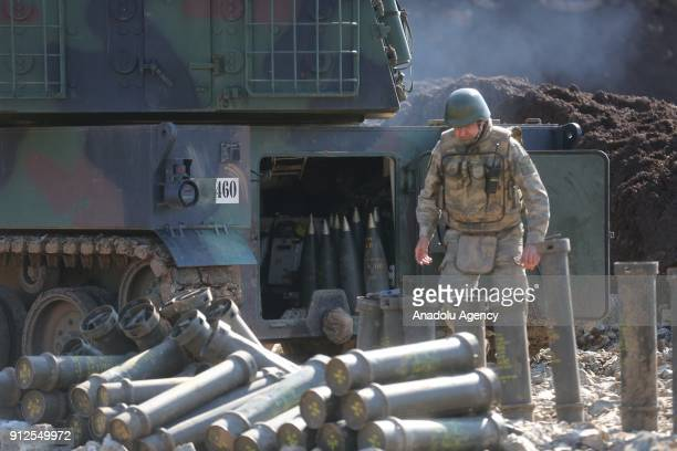A member of Turkish Armed Forces loads cannon balls to a domestic production howitzer as they continue to hit PYD/PKK terror group targets within the...