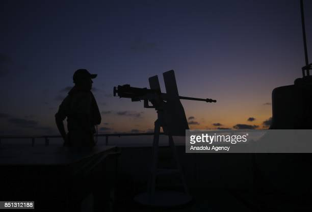 A member of Turkish Coast Guard Command is seen near a machine gun on a Turkish Coast Guard Command's ship at Black Sea in Istanbul Turkey on...