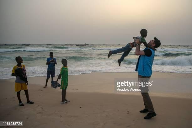 A member of Turkiye Diyanet Foundation greets a kid during the Eid AlAdha in Nouakchott Mauritania on August 12 2019 Muslims worldwide celebrate Eid...