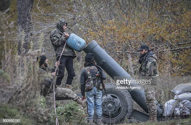 A member of Turkmen Brigades loads artillery as they fight to regain the control of Kizildag which is the most important region in the area in the...
