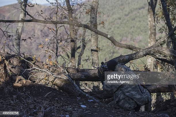 A member of Turkmen troops aims his rifle as he stands guard to protect Turkmen villages in the Bayirbucak region of Lattakia Syria on December 2...