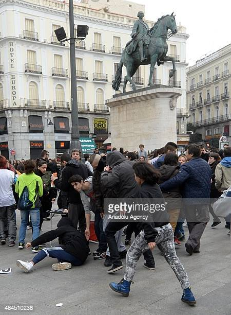 Member of two opposite groups fight each other during the demonstration held to protest the new laws enacted to make education reforms in Madrid...