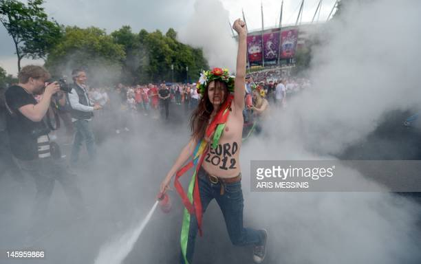 A member of Ukrainian feminist group Femen protests against prostitution near the National Stadium in Warsaw on June 8 before the opening match of...