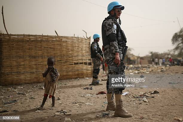 Member of UNAMID takes security measurements as almost 185000 Sudanese fled from civil war live at Zemzem camp in Darfur Sudan on April 12 2016
