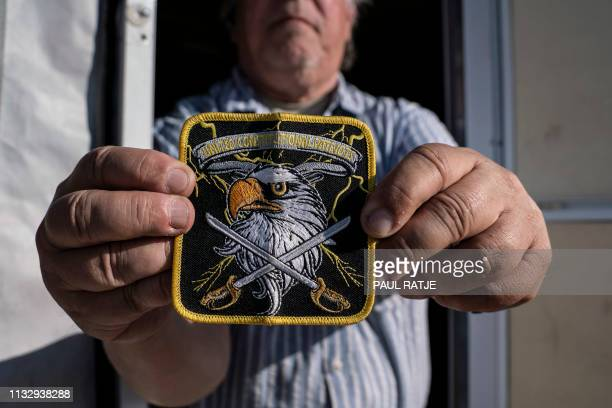 A member of United Constitutional Patriots New Mexico Border Ops militia team shows their group's patch outside their camper in Anapra New Mexico on...