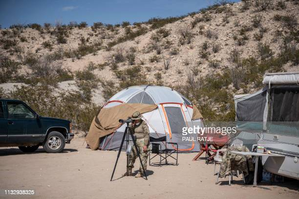 A member of United Constitutional Patriots New Mexico Border Ops militia team monitors the USMexico border in Anapra New Mexico on March 20 2019 The...
