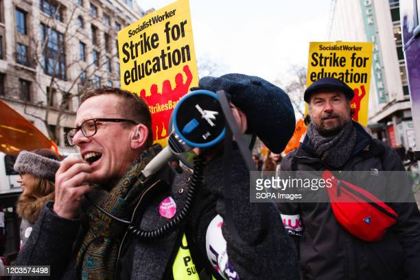 Member of University and College Union chants slogans on a megaphone during the demonstration. The UCU launched a 14-day strike on February 20 in...